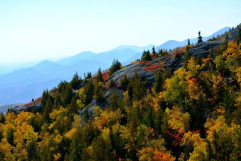 Happy Fall Friday! This magnificient view was taken hiking along Rocky Peak Ridge, in New Yorks Adirondack mountains region. Eastern Canada and New England is the destination to visit for your next fall vacation.