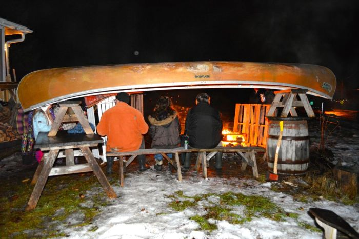 Celebrating the new year by taking shelter under an upturned canoe fireside in Wakefiled.