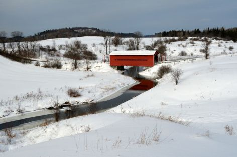 Winter at the Chelsea Bridge over Meech Creek near Wakefield, one of seven covered bridges remaining in the Gatineau Valley of Quebec. There is another longer bridge the town of Wakefield popular with tourist. In the 1900's there were over 1000 such bridges in the Province.