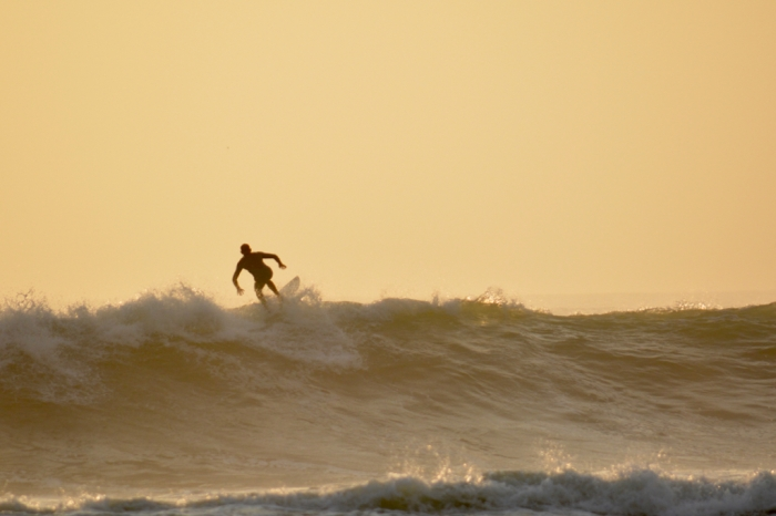 Surfing at sunset in Huanchaco