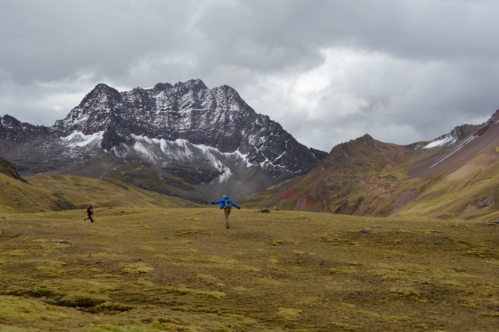 Woman and child running in the Peruvian Andes