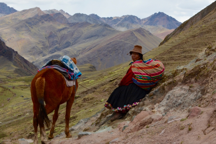 Woman and horse of the Vilcanota Mountain Range, Peru, Rainbow Mountain