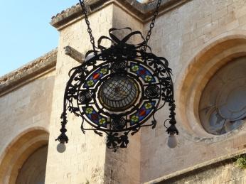 Hanging light fixture near the Basilica