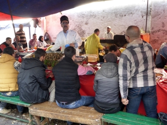 A cook at a lunch stall in the Port de Pêche of Casablanca