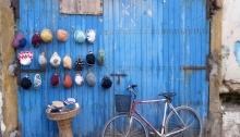Blue door, bike and hats, Essaouira, Morocco