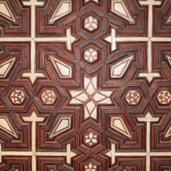 Geometric design of ebony and ivory on a door. Coptic Cairo