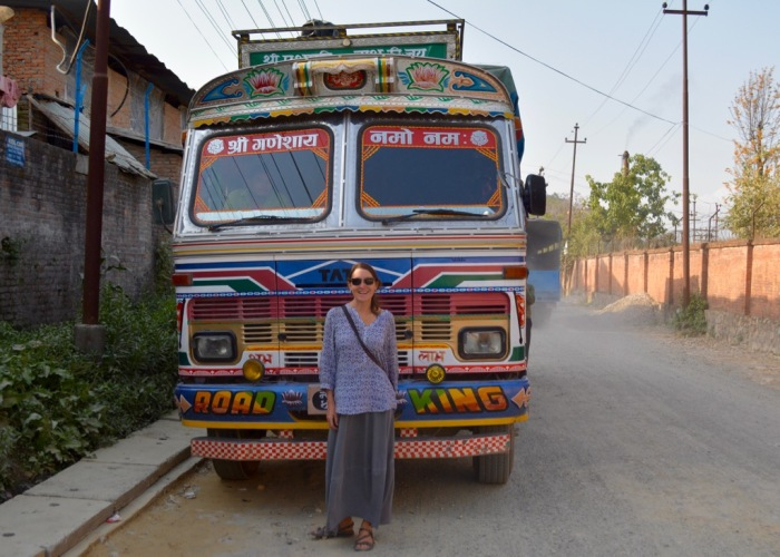 Woman and Road King Tata truck